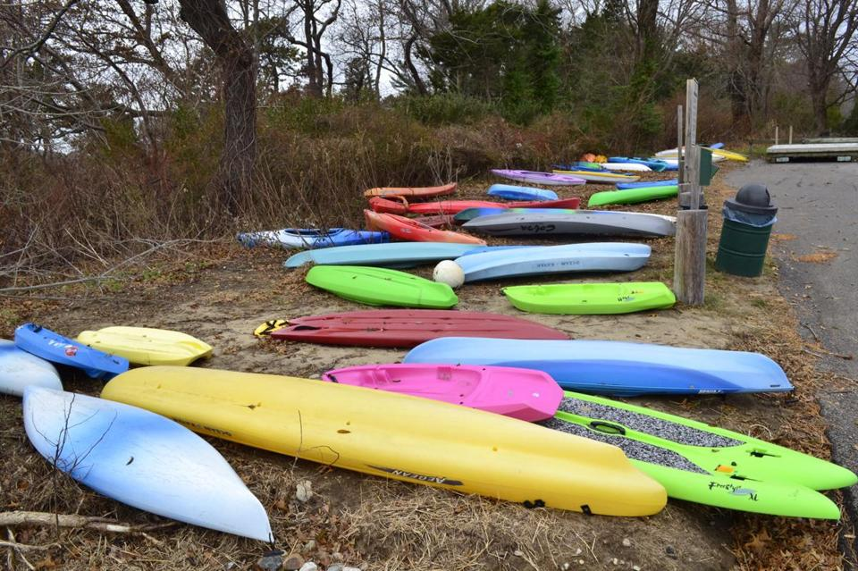 Dozens and dozens of standup paddleboards and kayaks have been left behind on town property in Duxbury. Police want them gone, calling it a big problem.