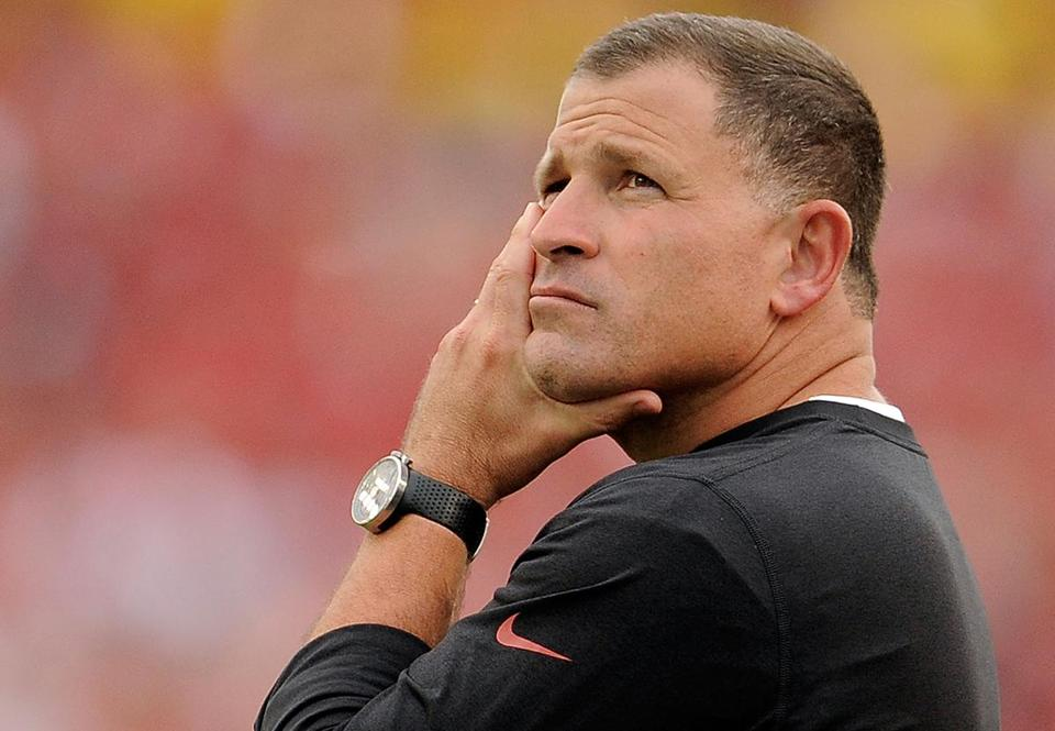FILE - DECEMBER 30: According to reports December 30, 2013, the Tampa Bay Buccaneers have fired head coach Greg Schiano. TAMPA, FL - DECEMBER 15: Greg Schiano, head coach of the Tampa Bay Buccaneers, watches the action during a game against the San Francisco 49ers at Raymond James Stadium on December 15, 2013 in Tampa, Florida. San Francisco won the game 33-14. (Photo by Stacy Revere/Getty Images)
