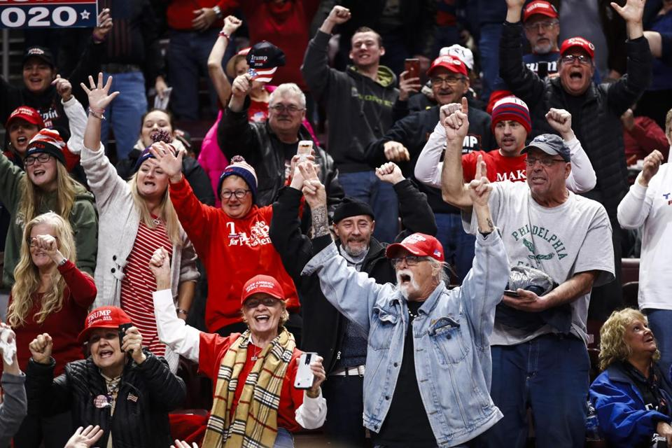 Attendees cheer ahead of a President Donald Trump campaign rally in Hershey, Pa., Tuesday, Dec. 10, 2019. (AP Photo/Matt Rourke)