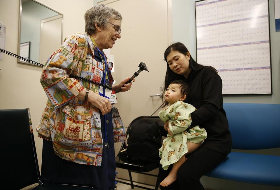 Dr. Deborah Frank checked ten-month-old Alana Nguyen's ears as her mother Hang held her during a visit at BMC.