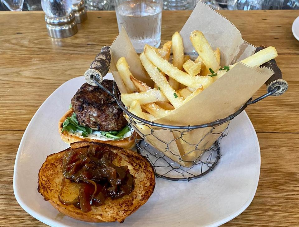 The lamb burger with caramelized onions and truffle fries at The Corner Stop.