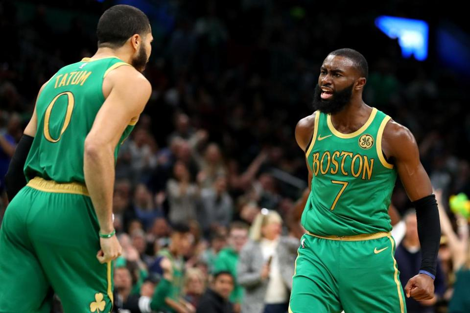 BOSTON, MASSACHUSETTS - DECEMBER 06: Jaylen Brown #7 of the Boston Celtics celebrates with Jayson Tatum #0 after scoring against the Denver Nuggets during the second half at TD Garden on December 06, 2019 in Boston, Massachusetts. The Celtics defeat the Nuggets 108-95. (Photo by Maddie Meyer/Getty Images)