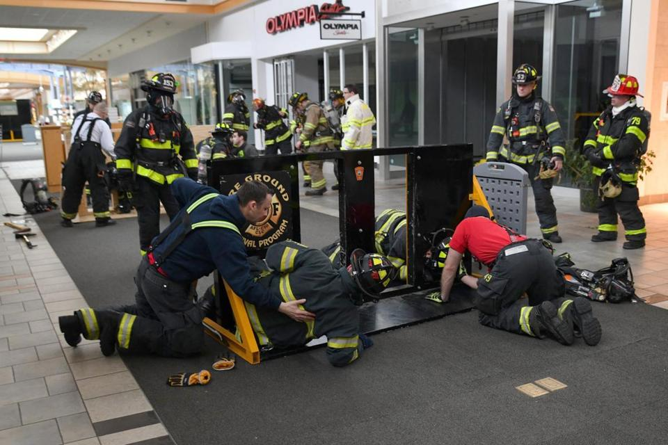 Firefighters from 11 communities used space at the closed Hanover Mall to train for two days, practicing survival skills such as freeing themselves from wires, using thermal imaging, breaching concrete walls, and ventilating roofs.