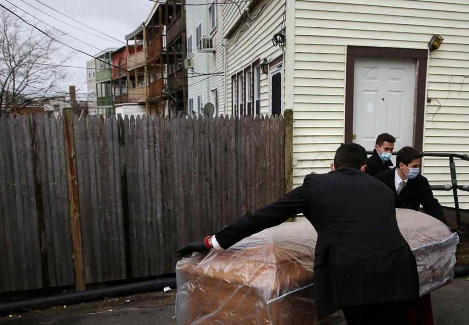 A funeral home copes with the surge during the coronavirus pandemic