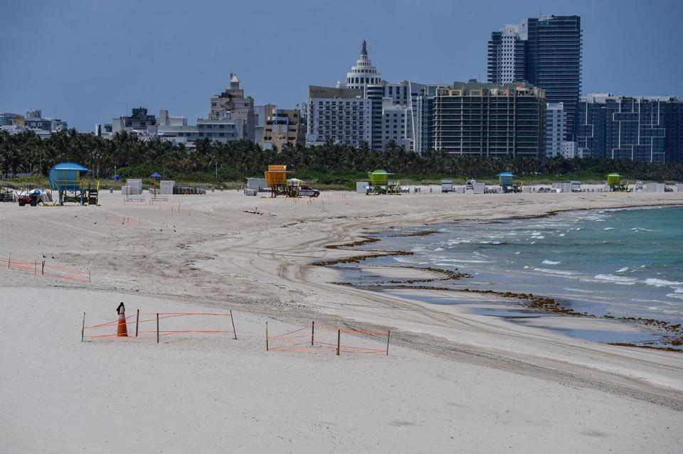 Miami Beach was quiet the day before the Fourth of July. Sun Belt states have seen sharply rising caseloads.