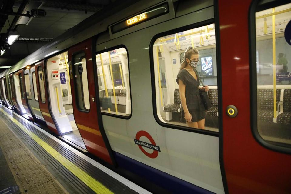 A passenger wore a face mask aboard a London Underground train in London on Friday.