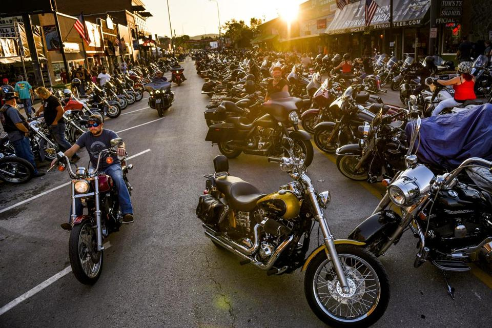 Motorcyclists drive down Main Street during the 80th Annual Sturgis Motorcycle Rally on Friday in Sturgis, South Dakota.