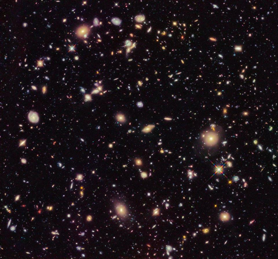 This image taken by the Hubble Space Telescope shows previously unseen early galaxies including the oldest one at 13.3 billion years old.