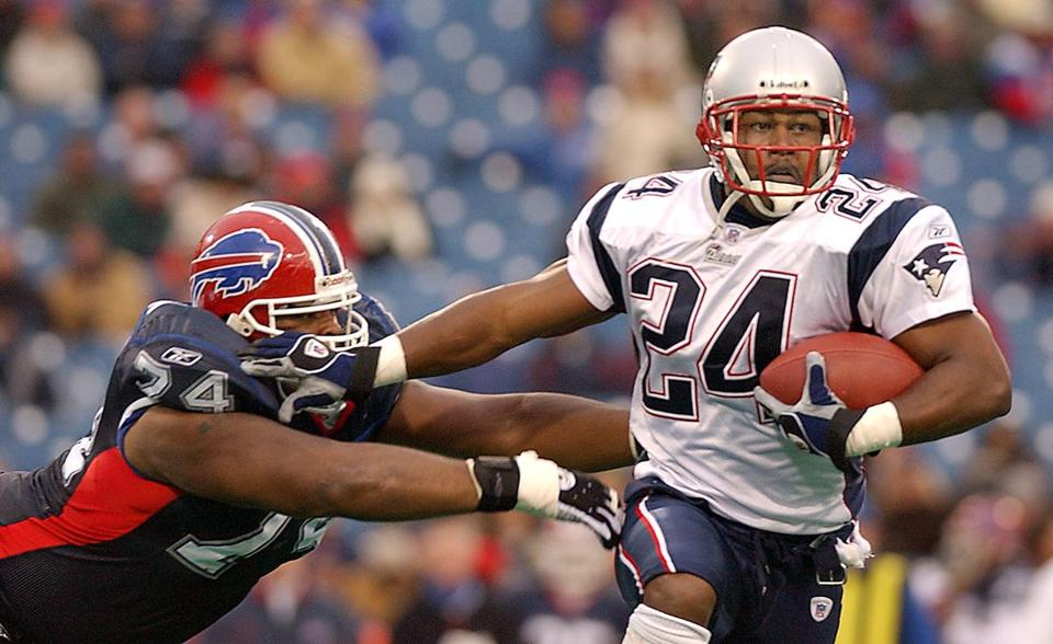 Ty Law runs back a Drew Bledsoe interception in 2002 against the Bills, one of his 53 career picks.