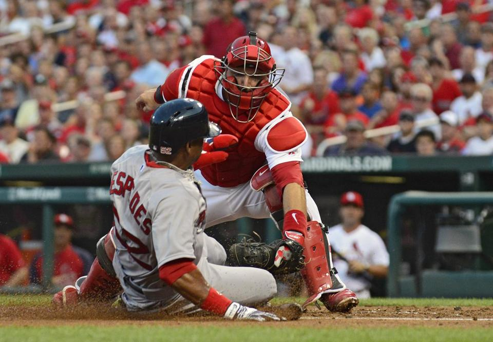 Cardinals catcher A.J. Pierzynski tagged out Red Sox left fielder Yoenis Cespedes during the second inning.