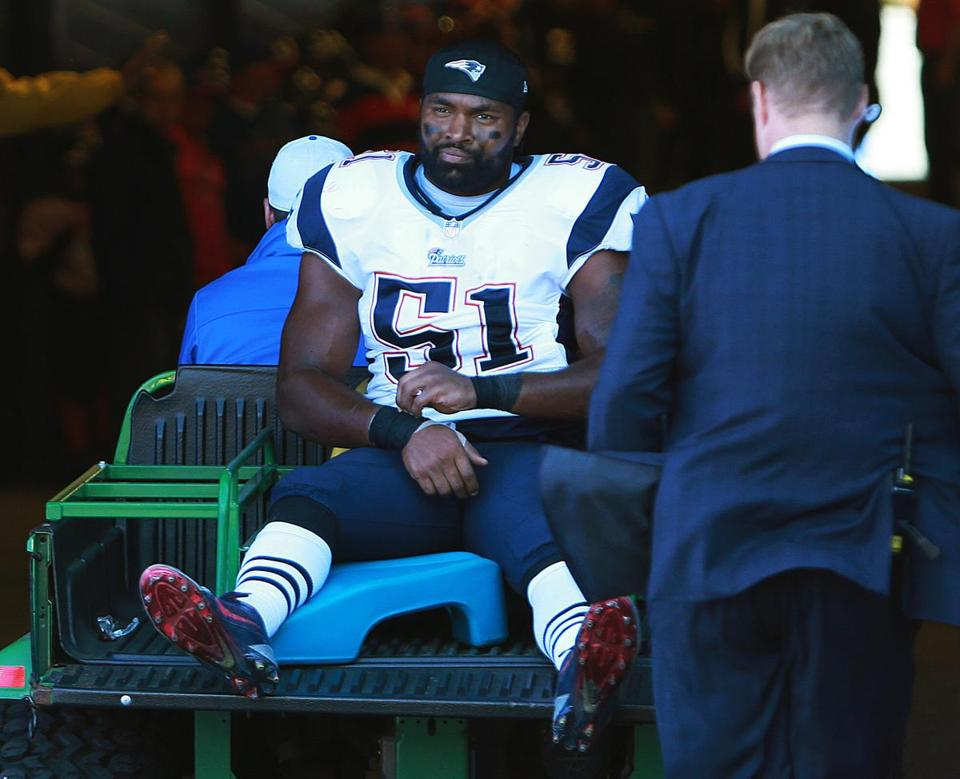 Jerod Mayo was taken to the locker room on a cart Sunday.