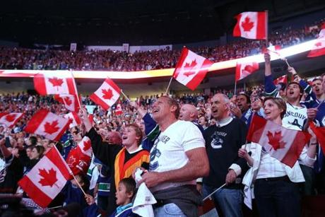Canucks fans waved Canadian flags prior to Game 7.