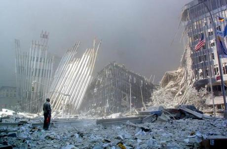 A man stands in the rubble, and calls out asking if anyone needs help, after the collapse of the first World Trade Center Tower 11 September, 2001, in New York. Two hijacked planes crashed into the twin towers causing the collapse of both. AFP PHOTO Doug KANTER Library Tag 09122001 NATIONAL AMERICA UNDER ATTACK, SEPTEMBER 11, 2001 NEW YORK Library Tag 01182011 G section