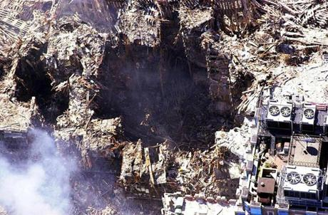 This photo released by the New York City Office of Emergency Management 17 September, 2001, shows an aerial view of the World Trade Center 16 September, 2001. The twin towers of the center were destroyed by terrorist crashing commercial jet planes into the structures. AFP PHOTO/POOL/NEW YORK CITY OFFICE OF EMERGENCY MANAGEMENT Library Tag 09182001 NATIONAL AMERICA UNDER ATTACK