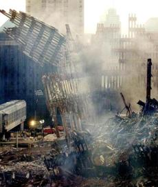 Workers pull down the remaining South wall of Tower Two of the World Trade Center with cables attached to cranes in New York September 25, 2001. Two hijacked commercial airliners were deliberately crashed into the twin towers bringing them crashing to the ground September 11. REUTERS/Jim Bourg Library Tag 09262001 NATIONAL AMERICA UNDER ATTACK