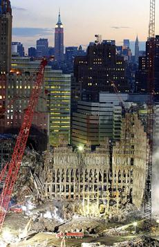 Work continues at the site of the World Trade Center disaster as a new day begins at sunrise in New York Saturday, Oct. 27, 2001. (AP Photo/David Karp) Library Tag 10282001 NATIONAL AMERICA UNDER ATTACK - NEW YORK