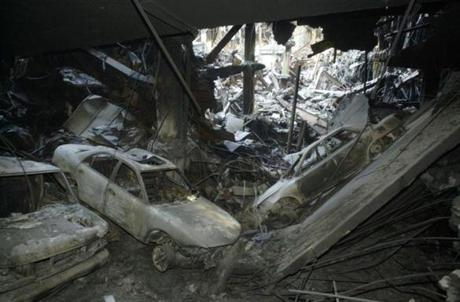 Vehicles that were destroyed are scattered about Wednesday, Nov. 14, 2001, on a buckled parking garage level underneath the World Trade Center in New York during a tour of the complex destroyed in the Sept.ll terrorist attack (AP Photo/Newark Star Ledger-John O'Boyle)MANDATORY CREDIT Library Tag 11162001 NATIONAL