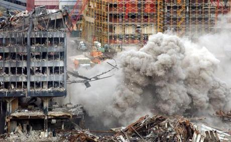 THIRD IN A SEQUENCE OF FOUR, XLL 104-107--A major section of Building Six collapses as demolition of the remains of The World Trade Center disaster site continues, Tuesday, Dec.18, 2001, in New York. (AP Photo/ Louis Lanzano) Library Tag 12192001 NATIONAL