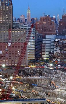 Recovery and cleanup efforts continue at New York's World Trade Center in this Dec. 22, 2001 file photo. The Empire State Building is visible at top center. (AP Photo/FILE/Louis Lanzano)
