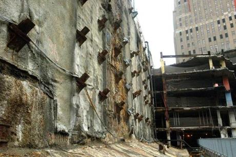 Pixs of the original wall of the World Trade Center, pixs show steel old cement and the new resh cement.