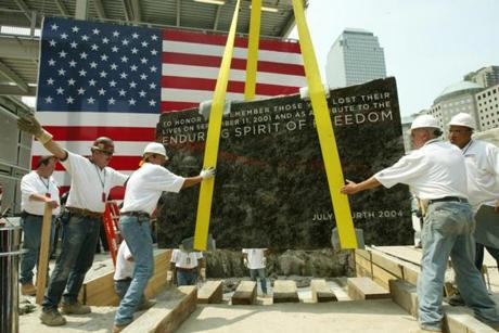 7/4/04/NYC.NY/Tower/ The cornerstone of the Freedom Tower, on the Location of the World trade Center, was laid today by workers- Here, after the ceremony , the stone was laid permanently(at 12:05)(credit james Estrin / The New York Times)