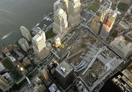 An aerial view showing the footprint of the World Trade Center site in lower Manhattan, with the Hudson River, left, on Friday Sept. 10, 2004 one day before the third anniversary of the terrorist attacks in the United States. (AP Photo/Stuart Ramson) ORG XMIT: XSR204