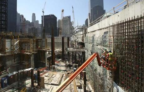 Construction continues on the Freedom Tower foundations at the World Trade Center site on Friday, June 20, 2008, in New York. In addition to the tower, three office towers, a transportation hub and the Sept. 11 memorial are under construction. (AP Photo/Mark Lennihan)