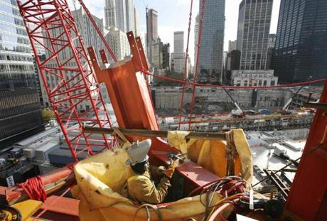 Ironworker Eon Mathieson prepares to connect a steel beam on the fourth floor of One World Trade Center, Tuesday, Nov. 17, 2009 in New York. The tower, also referred to as Freedom Tower, is now about 160 feet (49 meters) above ground level. (AP Photo/Mark Lennihan)