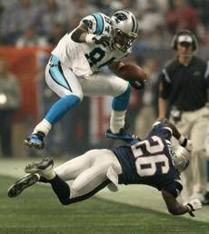 Wiggins leaped over defensive back Eugene Wilson for a Panthers first down in the third quarter.
