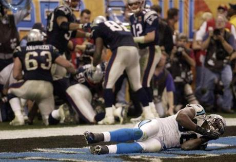 A short celebration by the Patriots, adjacent to the frustration of Panthers defensive end Al Wallace, was followed by a Kevin Faulk run for a two-point conversion.