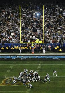 Adam Vinatieri drilled a 41-yard field goal with four seconds left to clinch the 32-29 victory.
