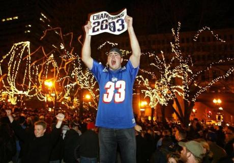 Thousands of New England Patriots fans celebrate in the streets around Boston's historic Faneuil Hall after the Patriots defeated the Carolina Panthers 32-29 to win Superbowl XXXVIII, February 1, 2004. REUTERS/Jim Bourg ORG XMIT: JRB04D 2004patsedit