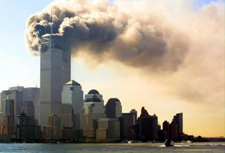 Smoke billows out of the top floors of the World Trade Center Towers 11 September 2001 in New York City. Witnesses say two separate planes flew into the towers, in what is suspected to be a terrorist attack. AFP PHOTO/HUBERT MICHAEL BOESL wtc9112001 finaledit day 1