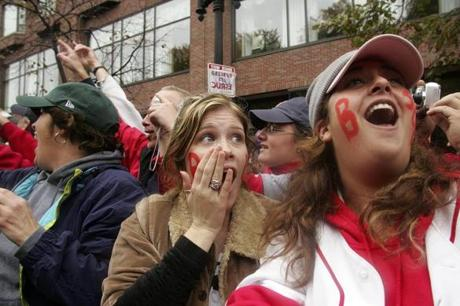Beth Harrison, center, and Gina Abysalh were among the red- and white-clad fans who lined the streets of Boston for the party.