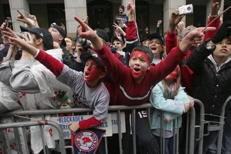 With the parade falling on a Saturday, young fans such as Colin Jones, 8,  left, and Walter Hannon, 10, were able to join the celebration without missing school.