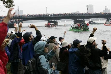 Fans lined the Charles River to cheer the Red Sox on as they sailed by in the amphibious vehicles.