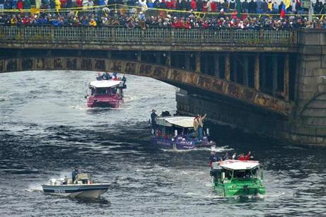 Fans lined the Longfellow Bridge as the Red Sox passed below them in the Duck Boats.