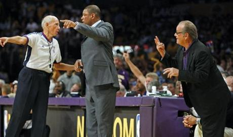Celtics head coach Doc Rivers, center, and Lakers fan Jack Nicolson both pleaded their case to referee Dick Bavetta during Game 5.