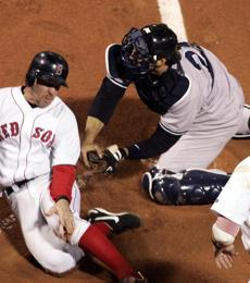 Yankees catcher Jorge Posada tagged Red Sox third baseman Bill Mueller out at the plate in the third inning of Game 3. The game was a washout for Boston, which lost 19-8 and fell behind 3-0 in the series.