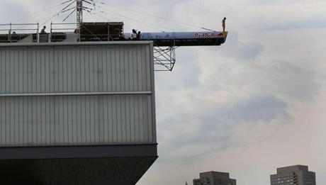 Kent De Mond, 28, prepares to dive from the roof of the Institute of Contemporary Art.