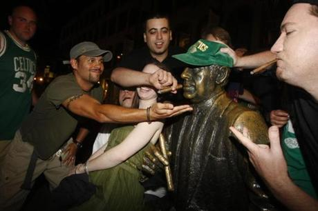 Fans flocked to the statue of Red Auerbach near Faneuil Hall after Game 6.
