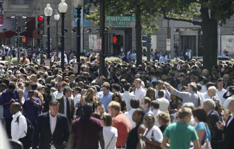 People crowded Pennsylvania Avenue in Washington, DC, as they evacuated buildings.