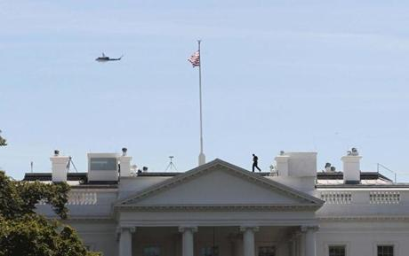 A Park Service helicopter patrolled over the White House as a member of the Secret Service walked across the roof following the earthquake.