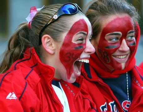 Stephanie Chaves and Michelle Zullo of Everett were among the fans cheering on the Red Sox during the parade.