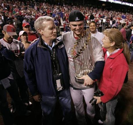 Lester, just a year removed from a fight against cancer, celebrated with his parents after earning the win in Game 4.