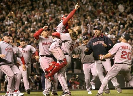 The Red Sox erupted from the dugout to celebrate on the Coors Field turf.