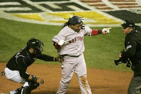 A disappointed Ramirez reacted to being called out at home plate by umpire Ted Barrett. The Red Sox claimed Game 3 10-5.