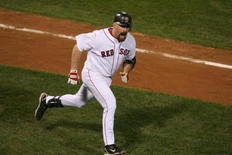Kevin Youkilis headed for home after slamming a home run in the eighth inning of the Red Sox' 11-2 win against the Indians in Game 7 of the ALCS.