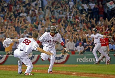 Jonathan Papelbon, left, congratulated Manny Ramirez after he hit a walk-off home run to win Game 2 of the ALDS against the Angels.
