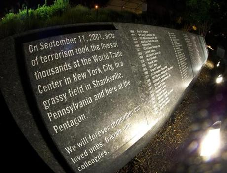 A memorial that is etched in stone is seen with the names of the 911 victims at the Pentagon Memorial, August 21, 2011, at the Pentagon in Washington, DC. It is a permanent outdoor memorial to the 184 men, women, and children who lost their lives as victims of the attack, killed both in the building and on American Airlines Flight 77 in the September 11, 2001 attacks. Across the memorial grounds, 184 bench-like structures, each one dedicated to a victim, are clustered in what seems like an uneven and unsettling array throughout the main grounds of the memorial. AFP Photo/Paul J. Richards (Photo credit should read PAUL J. RICHARDS/AFP/Getty Images) airlinegallery